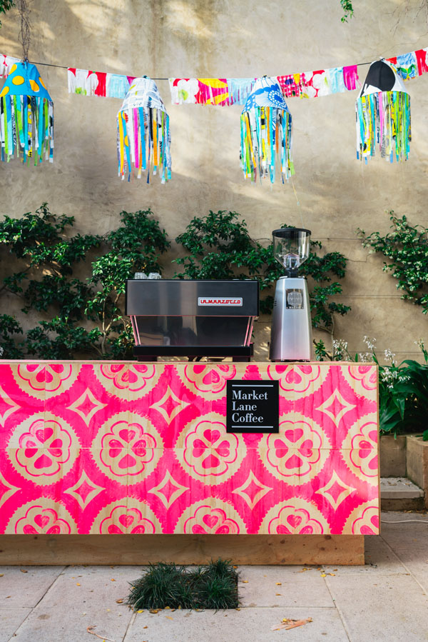 Market Lane Coffee set up in courtyard.  Plywood tiles by Bonnie and Neil.  Hanging decorations by Marsha Golemac using Marimekko fabric.   Photo - Brooke Holm.